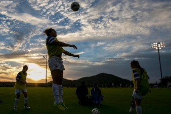 """A player warms up as the sun sets during an Elite Clubs National League (ECNL) soccer tournament at the Reach 11 Sports Complex in Phoenix, Arizona Friday, November 14, 2014."""