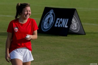 """A player laughs as she warms up during an Elite Clubs National League (ECNL) soccer tournament at the Reach 11 Sports Complex in Phoenix, Arizona Friday, November 14, 2014."""