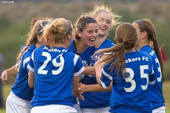 """A team celebrates after scoring a goal during an Elite Clubs National League (ECNL) soccer tournament at the Reach 11 Sports Complex in Phoenix, Arizona Friday, November 14, 2014."""