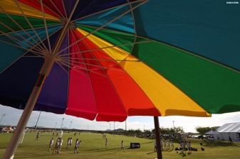 """An umbrella is shown as play goes on during an Elite Clubs National League (ECNL) soccer tournament at the Reach 11 Sports Complex in Phoenix, Arizona Friday, November 14, 2014."""
