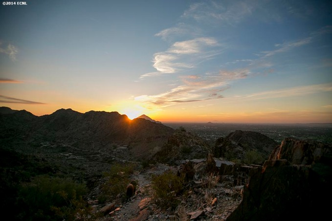 """The sun rises over Piestewa Peak during an Elite Clubs National League (ECNL) soccer tournament at the Reach 11 Sports Complex in Phoenix, Arizona Sunday, November 16, 2014."""