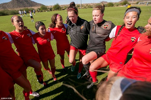 """A team cheers in the huddle during an Elite Clubs National League (ECNL) soccer tournament at the Reach 11 Sports Complex in Phoenix, Arizona Sunday, November 16, 2014."""