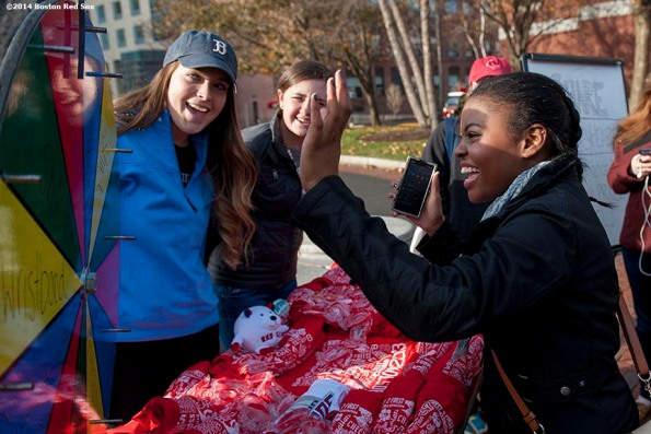 """""""A student spins a prize wheel during a Boston Red Sox Foundation fundraising event at Northeastern University in Boston, Massachusetts Thursday, December 4, 2014. """""""