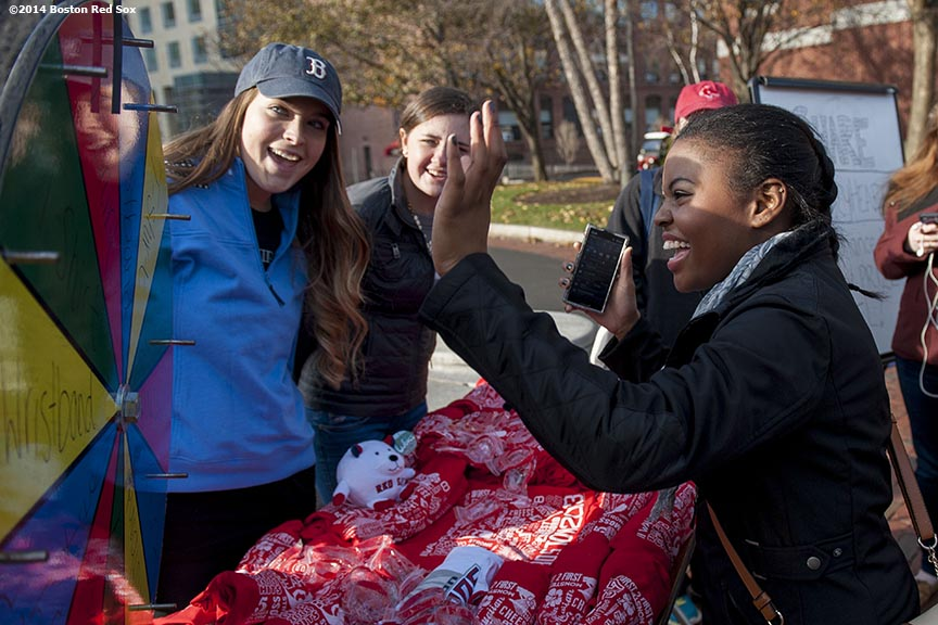 """A student spins a prize wheel during a Boston Red Sox Foundation fundraising event at Northeastern University in Boston, Massachusetts Thursday, December 4, 2014. """