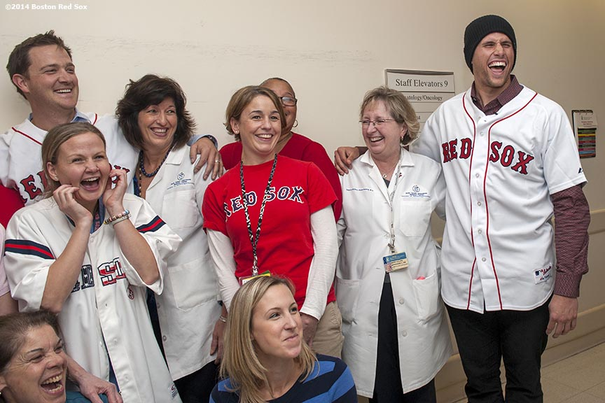 """""""Boston Red Sox infielder Garin Cecchini and pitcher Steven Wright pose for a photograph with staff during a visit to Beth Israel Deaconess Medical Center as part of the Red Sox Holiday Caravan Thursday, December 11, 2014 in Boston, Massachusetts."""""""
