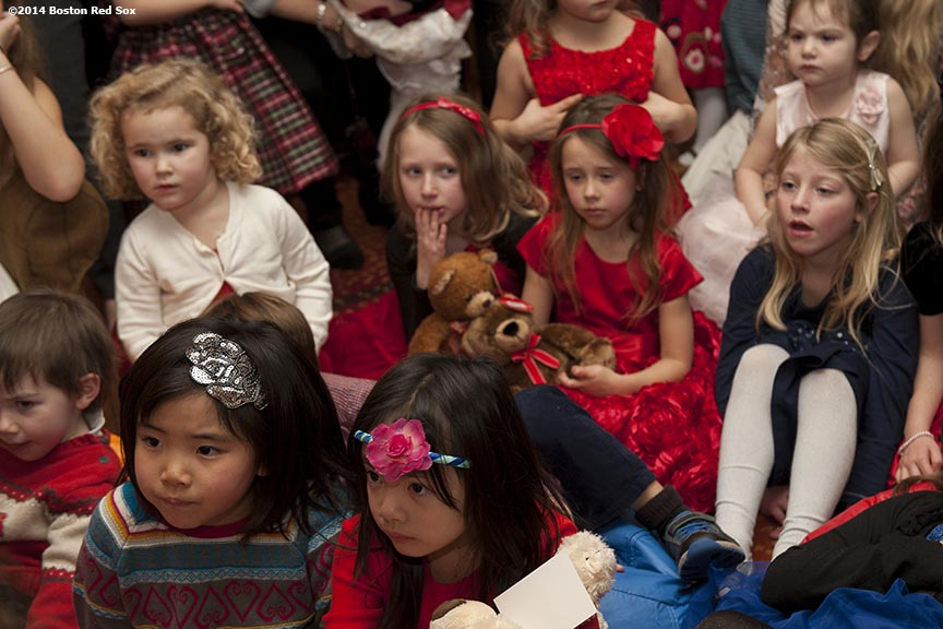 """Kids listen as Boston Red Sox pitcher Steven Wright reads a story at the Four Seasons Hotel as part of the Red Sox Holiday Caravan Friday, December 12, 2014 in Boston, Massachusetts."""