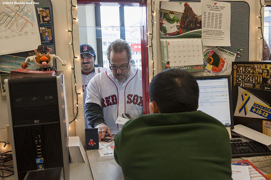 """Fans purchase tickets at the box office during Christmas At Fenway Saturday, December 13, 2014 at Fenway Park in Boston, Massachusetts."""