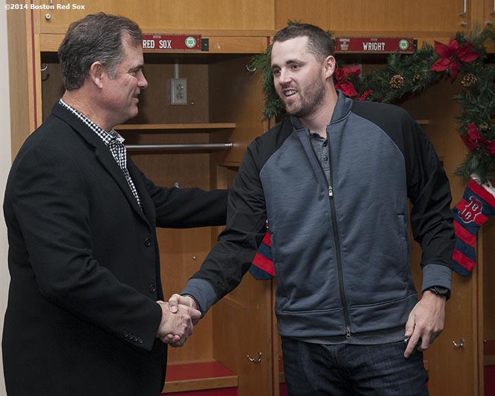 """Boston Red Sox manager John Farrell and pitcher Heath Hembree shake hands during Christmas At Fenway Saturday, December 13, 2014 at Fenway Park in Boston, Massachusetts."""