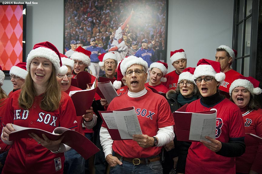 """A choir performs during the Great Fenway Park Yard Sale during Christmas At Fenway Saturday, December 13, 2014 at Fenway Park in Boston, Massachusetts."""