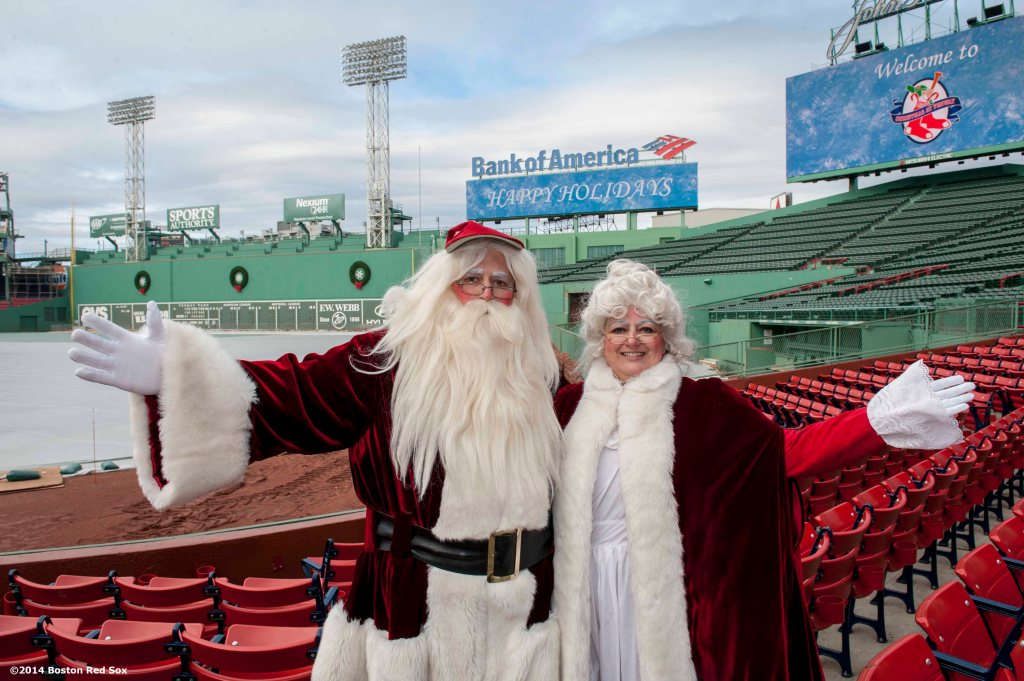 """Santa Claus and Mrs. Claus pose for a photograph during Christmas At Fenway Saturday, December 13, 2014 at Fenway Park in Boston, Massachusetts."""