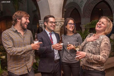 """Guests mingle in the courtyard during a 'Winter Solstice' themed Third Thursdays at the Isabella Stewart Gardner Museum in Boston, Massachusetts Thursday, December 18, 2014."""