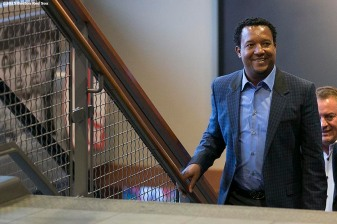 """Former Boston Red Sox pitcher Pedro Martinez walks up the stairs before addressing the media during a press conference after being informed that he was inducted into the Major League Baseball Hall of Fame at Fenway Park in Boston, Massachusetts Tuesday, January 6, 2015."""