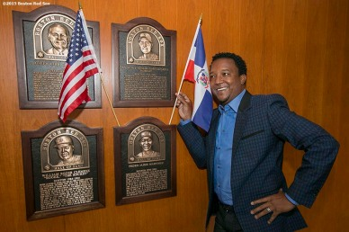 """Former Boston Red Sox pitcher Pedro Martinez poses next to his Boston Red Sox Hall of Fame plaque after being informed that he was inducted into the Major League Baseball Hall of Fame at Fenway Park in Boston, Massachusetts Tuesday, January 6, 2015."""
