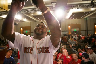 """Boston Red Sox third baseman Pablo Sandoval takes a selfie during a kids press conference during the Red Sox Winter Weekend at Foxwoods Resort and Casino in Ledyard, Connecticut Saturday, January 24, 2015."""
