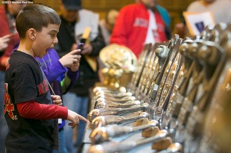 """A fan looks at the silver slugger awards during the Red Sox Winter Weekend at Foxwoods Resort and Casino in Ledyard, Connecticut Saturday, January 24, 2015."""