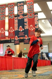 """A fan participates in the steal home challenge during the Red Sox Winter Weekend at Foxwoods Resort and Casino in Ledyard, Connecticut Saturday, January 24, 2015."""