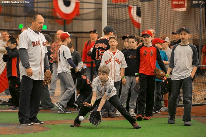 """Boston Red Sox first base coach Arnie Beyeler watches as kids field ground balls during a baseball clinic at the the Red Sox Winter Weekend at Foxwoods Resort and Casino in Ledyard, Connecticut Sunday, January 25, 2015."""
