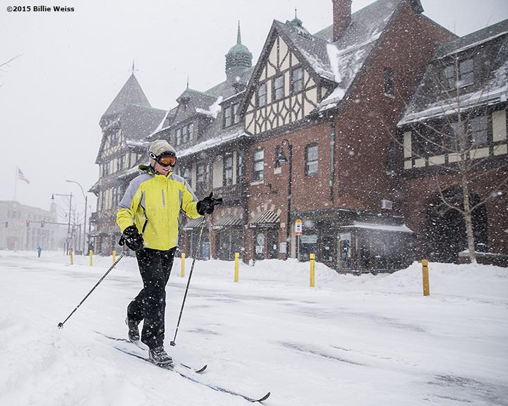 """A skier skis down Harvard Avenue during snow storm Juno in Brookline, Massachusetts Tuesday, January 27, 2015."""
