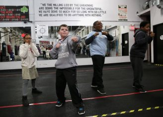 BOSTON, MA - JANUARY 09: Local kids practice boxing during a community event at Peter Welch's Gym on January 9, 2015 in Boston, Massachusetts. (Photo by Billie Weiss/Zuffa LLC/Zuffa LLC via Getty Images)