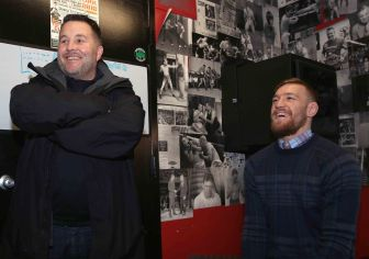 BOSTON, MA - JANUARY 09: UFC fighter Conor McGregor laughs alongside Dropkick Murphys lead singer Ken Casey during a community event at Peter Welch's Gym on January 9, 2015 in Boston, Massachusetts. (Photo by Billie Weiss/Zuffa LLC/Zuffa LLC via Getty Images)