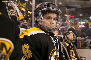 """Make-A-Wish recipient Jimmy Bjorkman of West Salem, Wisconsin watches warm ups from the bench before a hockey game between the Boston Bruins and the Montreal Canadiens at TD Garden in Boston, Massachusetts Sunday, February 8, 2015."""