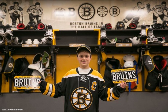 """""""Make-A-Wish recipient Jimmy Bjorkman of West Salem, Wisconsin poses in the Boston Bruins locker room after a hockey game between the Boston Bruins and the Montreal Canadiens at TD Garden in Boston, Massachusetts Sunday, February 8, 2015."""""""