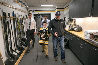 """Make-A-Wish recipient Jimmy Bjorkman of West Salem, Wisconsin is given a tour of the Boston Bruins locker room after a hockey game between the Boston Bruins and the Montreal Canadiens at TD Garden in Boston, Massachusetts Sunday, February 8, 2015."""