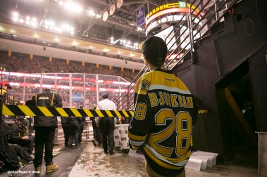 """Make-A-Wish recipient Jimmy Bjorkman of West Salem, Wisconsin checks the scoreboard before riding a zamboni during a hockey game between the Boston Bruins and the Montreal Canadiens at TD Garden in Boston, Massachusetts Sunday, February 8, 2015."""
