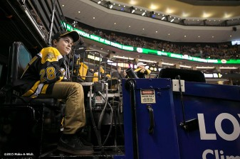 """Make-A-Wish recipient Jimmy Bjorkman of West Salem, Wisconsin rides a zamboni during a hockey game between the Boston Bruins and the Montreal Canadiens at TD Garden in Boston, Massachusetts Sunday, February 8, 2015."""