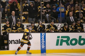 """Make-A-Wish recipient Jimmy Bjorkman of West Salem, Wisconsin skates out for the National Anthem with the Boston Bruins starting lineup before a hockey game between the Boston Bruins and the Montreal Canadiens at TD Garden in Boston, Massachusetts Sunday, February 8, 2015."""