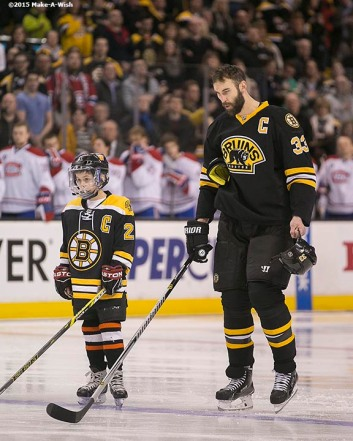 """""""Make-A-Wish recipient Jimmy Bjorkman of West Salem, Wisconsin skates out for the National Anthem with the Boston Bruins starting lineup before a hockey game between the Boston Bruins and the Montreal Canadiens at TD Garden in Boston, Massachusetts Sunday, February 8, 2015."""""""