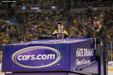"""""""Make-A-Wish recipient Jimmy Bjorkman of West Salem, Wisconsin rides a zamboni during a hockey game between the Boston Bruins and the Montreal Canadiens at TD Garden in Boston, Massachusetts Sunday, February 8, 2015."""""""