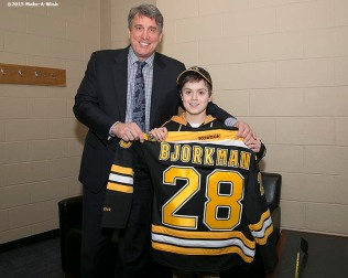"""""""Make-A-Wish recipient Jimmy Bjorkman of West Salem, Wisconsin meets Boston Bruins President Cam Neely and is presented with a jersey before a hockey game between the Boston Bruins and the Montreal Canadiens at TD Garden in Boston, Massachusetts Sunday, February 8, 2015."""""""