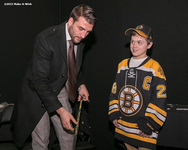 """""""Make-A-Wish recipient Jimmy Bjorkman of West Salem, Wisconsin meets Boston Bruins player Patrice Bergeron and is given one of his hockey sticks after a hockey game between the Boston Bruins and the Montreal Canadiens at TD Garden in Boston, Massachusetts Sunday, February 8, 2015."""""""