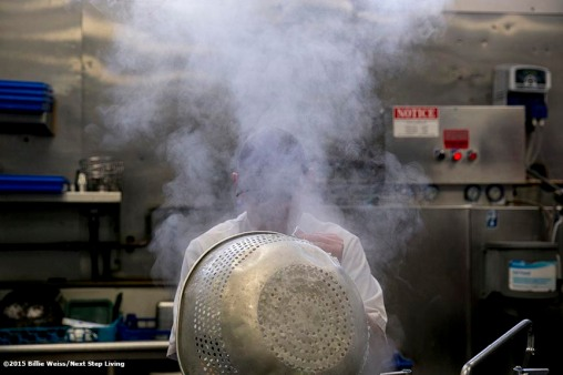 """""""A chef works in the kitchen of The Stockyard Steakhouse restaurant in Brighton, Massachusetts Tuesday, February 10, 2015."""""""