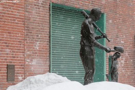 """The Ted Williams statue is shown as snow falls during Boston Red Sox truck day Thursday, February 12, 2015 at Fenway Park in Boston, Massachusetts."""