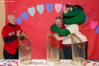 """""""A resident reacts as he is greeted by mascot Wally the Green Monster and former Boston Red Sox player Ted Lepcio during a Boston Red Sox Valentine's Day caravan to retirement and assisted living communities throughout greater Boston Friday, February 13, 2015."""""""