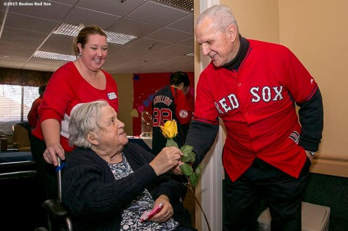 """""""Former Boston Red Sox player Ted Lepcio gives a resident a rose during a Boston Red Sox Valentine's Day caravan to retirement and assisted living communities throughout greater Boston Friday, February 13, 2015."""""""