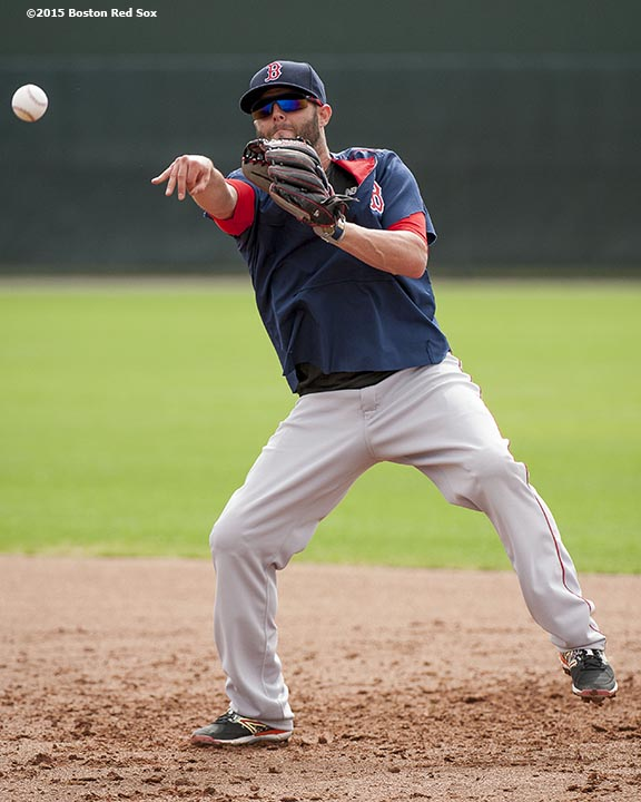 """Boston Red Sox second baseman Dustin Pedroia throws during a team workout at JetBlue Park in Fort Myers, Florida Wednesday, February 25, 2015."""