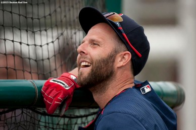 """Boston Red Sox second baseman Dustin Pedroia smiles as he takes batting practice during a team workout at JetBlue Park in Fort Myers, Florida Wednesday, February 25, 2015."""