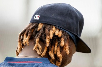 """The hair of Boston Red Sox left fielder Hanley Ramirez is shown during a team workout at JetBlue Park in Fort Myers, Florida Wednesday, February 25, 2015."""