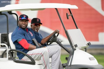 """Boston Red Sox designated hitter David Ortiz and former pitcher Luis Tiant ride in a golf cart during a team workout at JetBlue Park in Fort Myers, Florida Wednesday, February 25, 2015."""