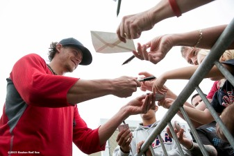"""Boston Red Sox pitcher Clay Buchholz signs autographs for fans during a team workout at JetBlue Park in Fort Myers, Florida Thursday, February 26, 2015."""