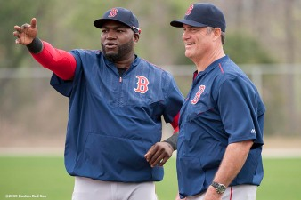 """Boston Red Sox designated hitter David Ortiz talks with manager John Farrell during a team workout at JetBlue Park in Fort Myers, Florida Thursday, February 26, 2015."""