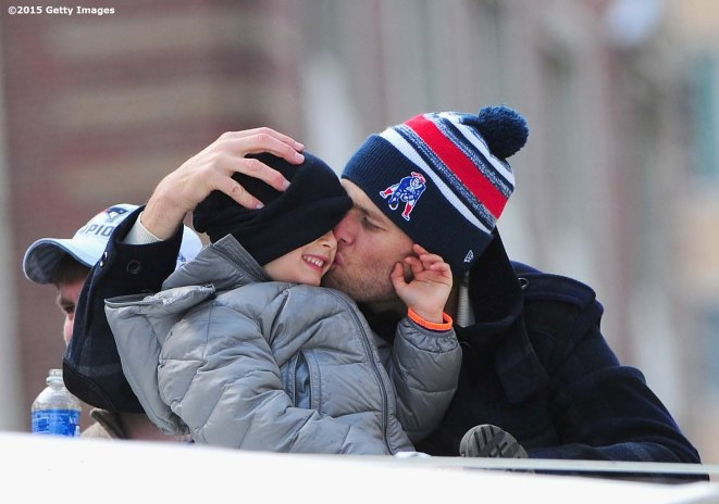 BOSTON, MA - FEBRUARY 04: Quarterback Tom Brady of the New England Patriots kisses his son Benjamin during a Super Bowl victory parade on February 4, 2015 in Boston, Massachusetts. (Photo by Billie Weiss/Getty Images)