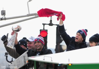 BOSTON, MA - FEBRUARY 04: Quarterbacks Jimmy Garoppolo and Tom Brady of the New England Patriots wave during a Super Bowl victory parade on February 4, 2015 in Boston, Massachusetts. (Photo by Billie Weiss/Getty Images)