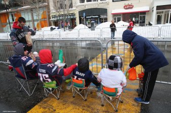BOSTON, MA - FEBRUARY 04: Fans camp out at the finish line of the Boston Marathon before the New England Patriots Super Bowl victory parade on February 4, 2015 in Boston, Massachusetts. (Photo by Billie Weiss/Getty Images)