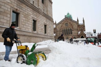 BOSTON, MA - FEBRUARY 04: A worker blows snow in front of the Boston Public Library in Copley Square before the New England Patriots Super Bowl victory parade on February 4, 2015 in Boston, Massachusetts. (Photo by Billie Weiss/Getty Images)