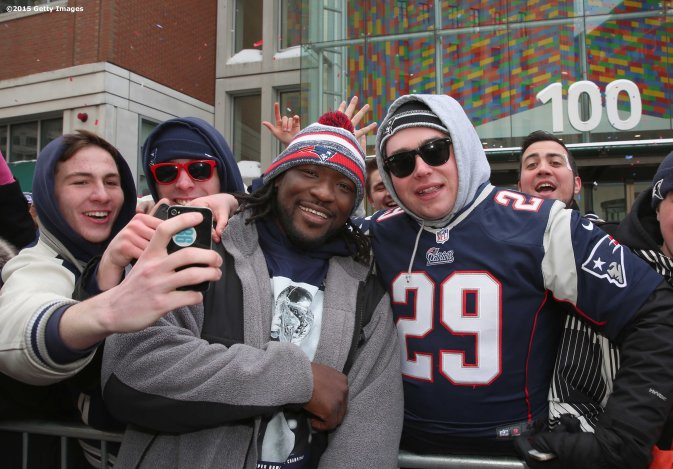 BOSTON, MA - FEBRUARY 04: LeGarrette Blount of the New England Patriots poses for a photograph with fans during a Super Bowl victory parade on February 4, 2015 in Boston, Massachusetts. (Photo by Billie Weiss/Getty Images)