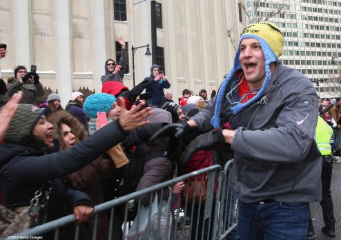 BOSTON, MA - FEBRUARY 04: Tight end Rob Gronkowski of the New England Patriots high fives fans during a Super Bowl victory parade on February 4, 2015 in Boston, Massachusetts. (Photo by Billie Weiss/Getty Images)